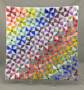 "Homage I, 15.75"" x 15.75"" x 1.75"", Fused and Slumped Kiln-Formed Glass Platter made from  hand-crafted components including glass bars fused ""on-edge"" and cut to create the rainbow of triangle  pieces and white and black dots made from glass rods."